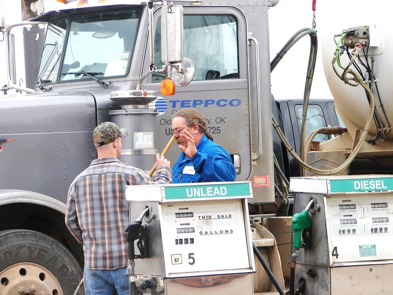Bobcat, the teppco driver, showing the new hand Kenny how to wash windshields